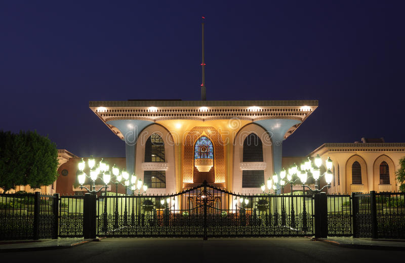 King`s Palace in Muscat, Oman. King`s Palace illuminated at night. Muscat, Sultanate of Oman stock photo