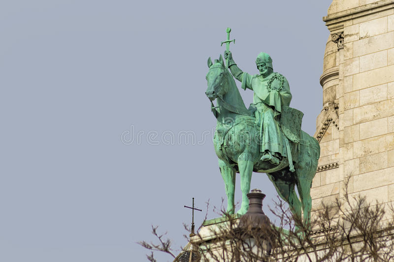 King Saint Louis. Equestrian Statue of King Saint Louis at the entrance of the basilica Sacred Heart of paris under a clear and sunny sky stock image