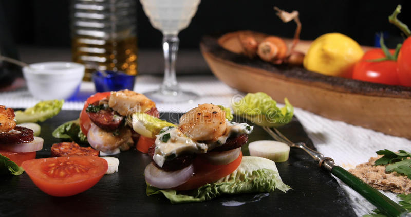 King scallops with chorizo in garlic mayonnaise stock photography