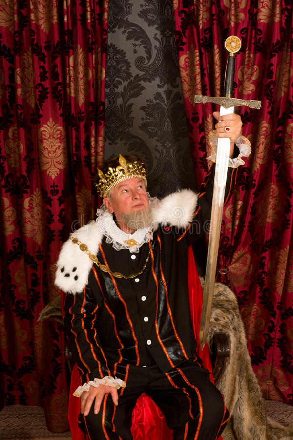King showing sword stock photo