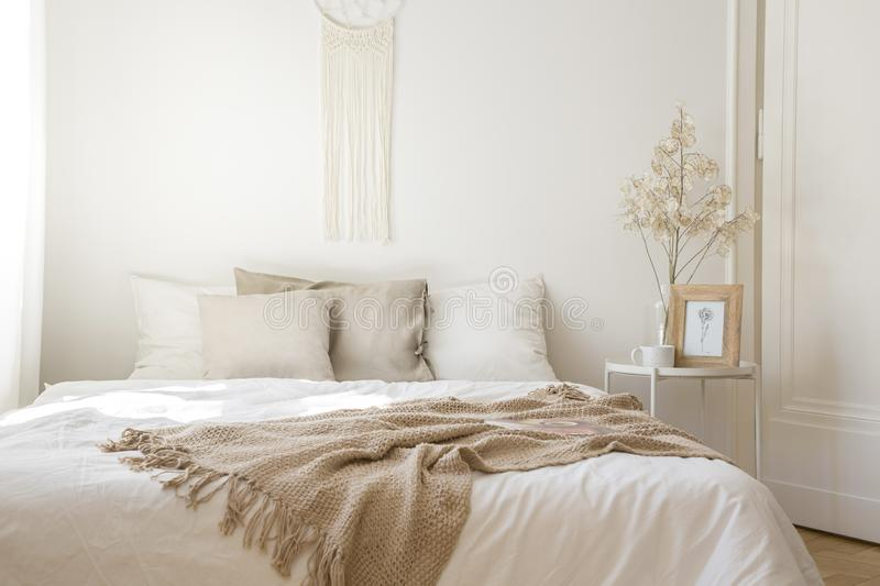 King size bed with white and beige pillows, real photo royalty free stock images