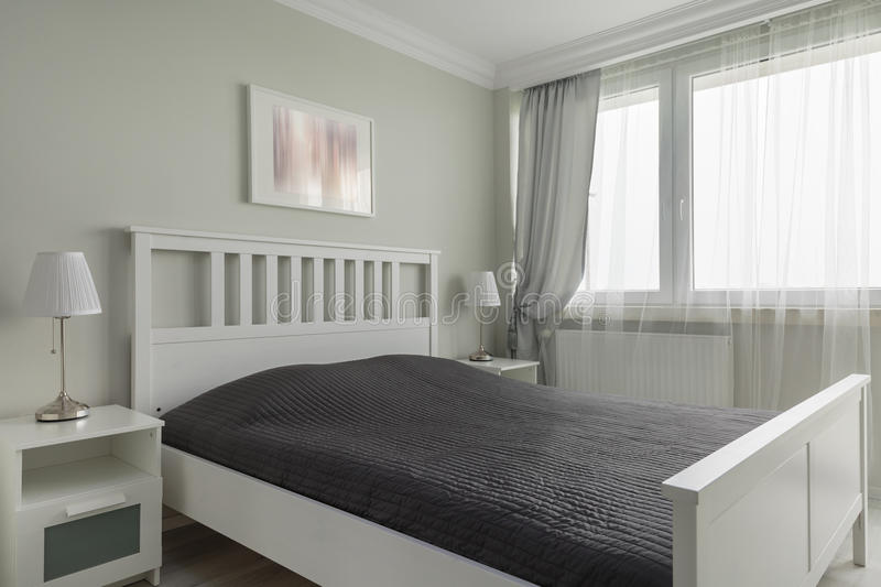 King size white bed royalty free stock image