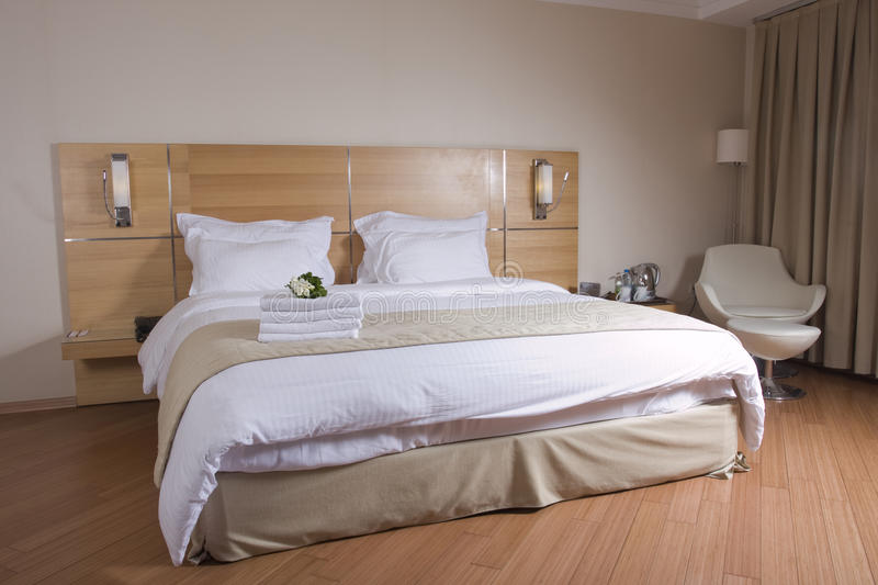 Download King Sized Bed With White Flowers Stock Photo - Image: 25589080