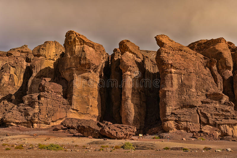 King Solomons pillars Israel. Panoramic view of the red Sandstone cliffs in Timna Valley called after King Solomon`s Pillars at the first Jewish Temple in royalty free stock photos