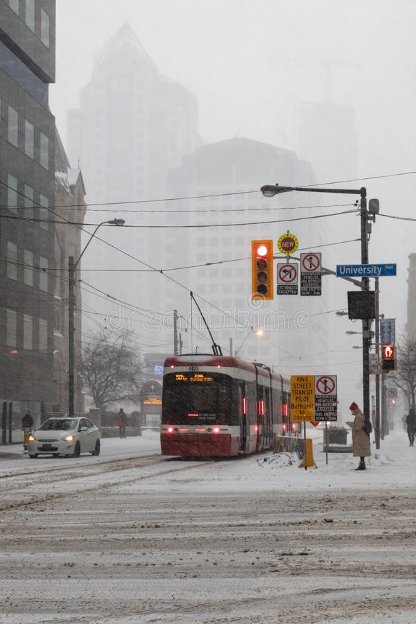 King Street Street Car Snow Storm Canada Toronto Feb 12 2019 stock photo