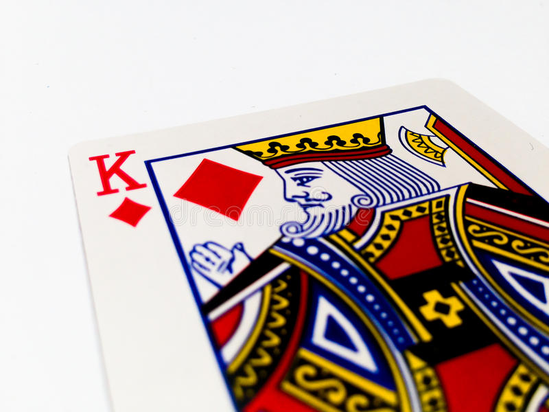 King Tiles / Diamonds Card with White Background. A playing card is a piece of specially prepared heavy paper, thin cardboard, plastic-coated paper, cotton-paper stock photo