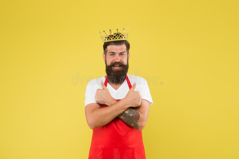 Kingdom of tastes. Chief cook and professional culinary. Premium quality. Cook food. Cook with beard and mustache yellow royalty free stock photography