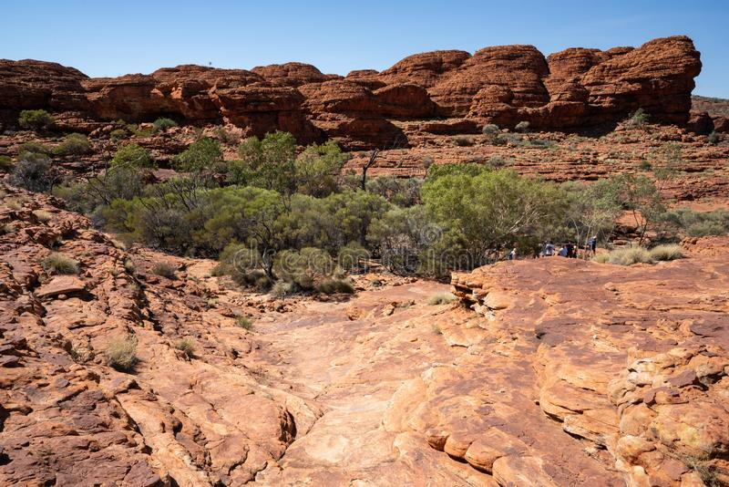 Kings canyon landscape with hiking path during the Rim walk in outback Australia. Kings canyon landscape with hiking path during the Rim walk in NT outback stock image