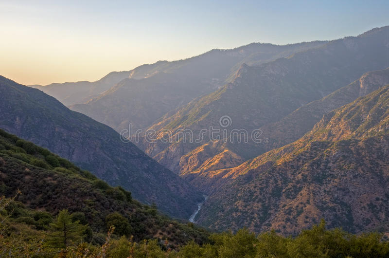 Kings Canyon Sunset. The sun sets on the Kings River and Kings Canyon National Park, California royalty free stock image