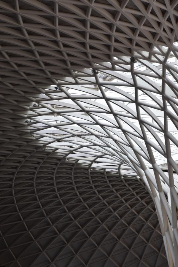 Kings Cross geometry in light and shadow. An abstract. Observation of light and shadow in balance at Kings Cross with its gorgeous curves in colorless steel stock image