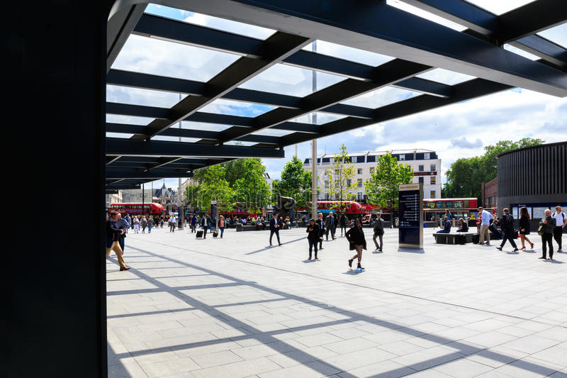 Kings Cross Square. London, UK - July 5, 2016 - Travellers walk around the forecourt of Kings Cross train station royalty free stock images