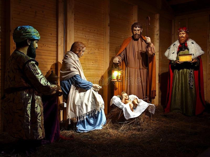Kings and holy family. Kings with gifts and a holy family in a traditional Polish crib stock images