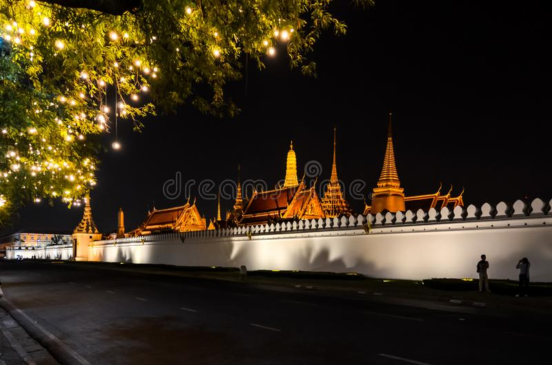 Kings palace from outside in Thailand at night. With empty street and many lights stock photo