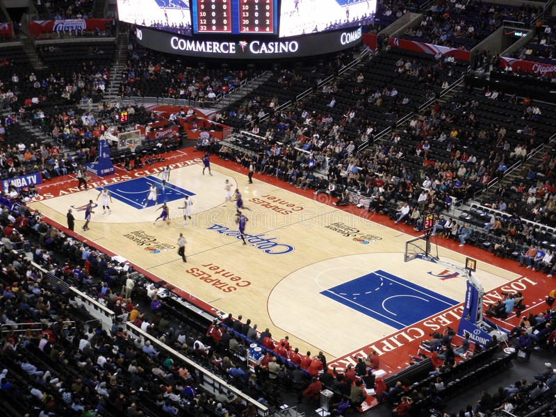 Kings player dribbles ball past Clippers player royalty free stock photo