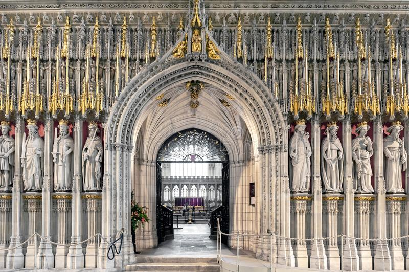 The Kings Screen inside the cathedral of York Minster in the UK. York, England - April 2018: The15th century stone screen called The Kings Screen curtained stock image