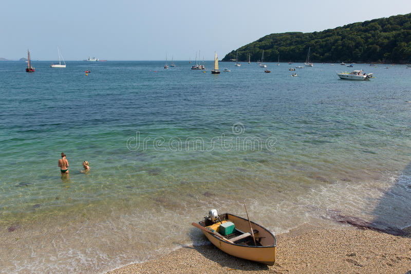 Kingsand beach Cornwall England United Kingdom on the Rame Peninsula overlooking Plymouth Sound. Holiday makers enjoying the summer heatwave at Kingsand beach royalty free stock image