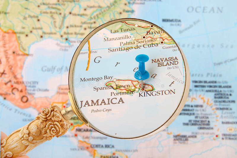 Kingston, Jamaica map. Blue tack on map of Caribbean with magnifying glass looking in on Kingston, Jamaica royalty free stock images