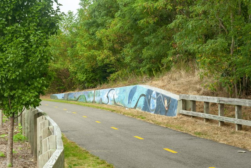 Decorated concrete wall on bike path. Kingston, Rhode Island, USA - September 9, 2007: Decorated concrete wall along a bend in the William C. O'Neill Bike stock photo