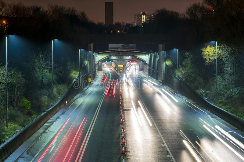 Kingsway Tunnel - Wirral to Liverpool Traffic. Long exposure picture. Rush hour traffic in the night on a busy road to the city of Liverpool. Mersey Tunnel. Slow royalty free stock images