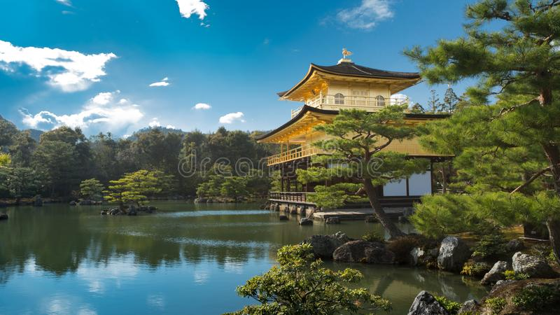 Kinkakuji & x28;Temple of golden pavilion& x29; in Kyoto with beautiful Zen garden. Under blue sky and white cloud, Kyoto, Japan stock photography