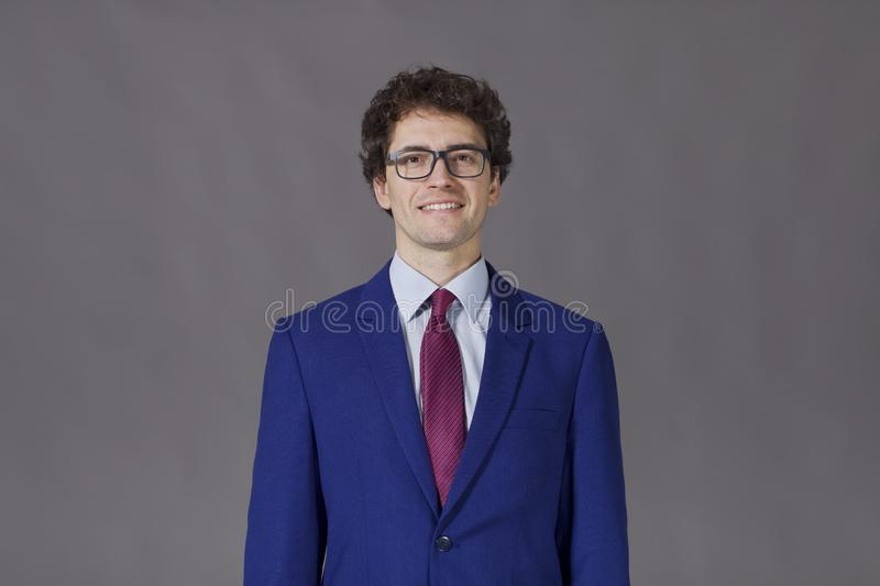 Kinky guy wearing a blue jacket royalty free stock images