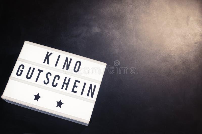 kino gutschein on word board in cinema theme stock photo image of