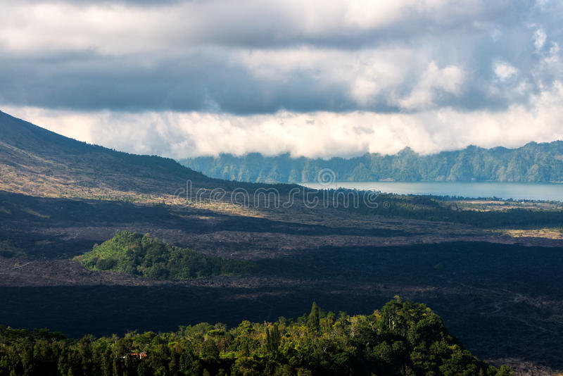 Kintamani Volcano and lake Batur Etna. View of Kintamani Volcano and lake Batur Etna with plenty of cloud over the top at Bali, Indonesia stock photography
