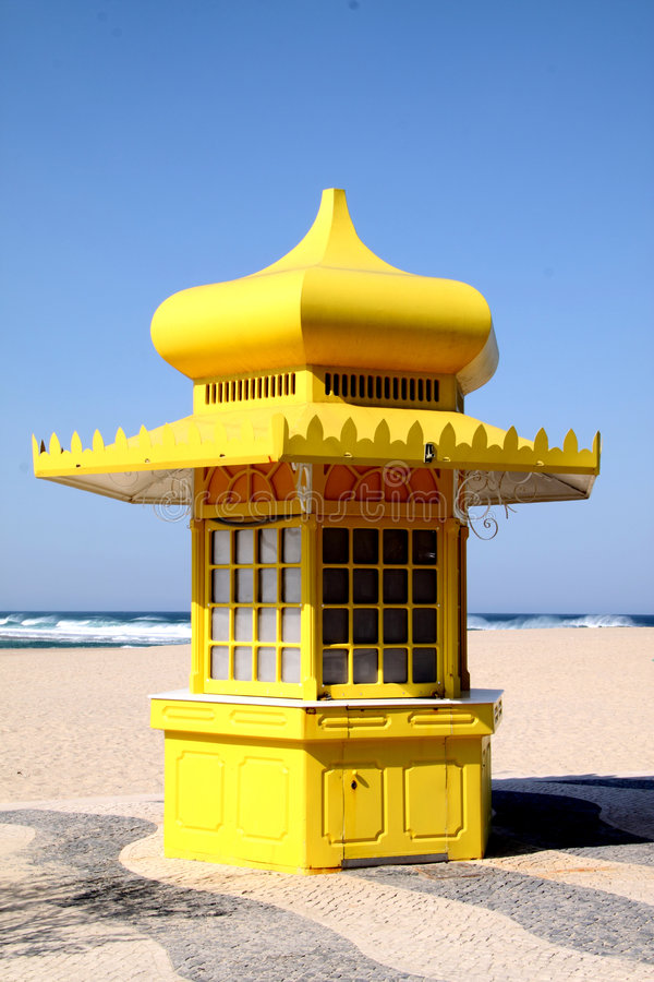 Kiosk yellow on the beach stock images