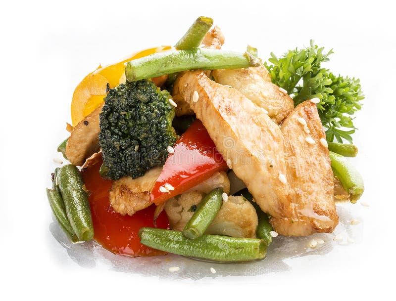 Kip, in WOK met groenten in sojasaus wordt gebraden die royalty-vrije stock foto