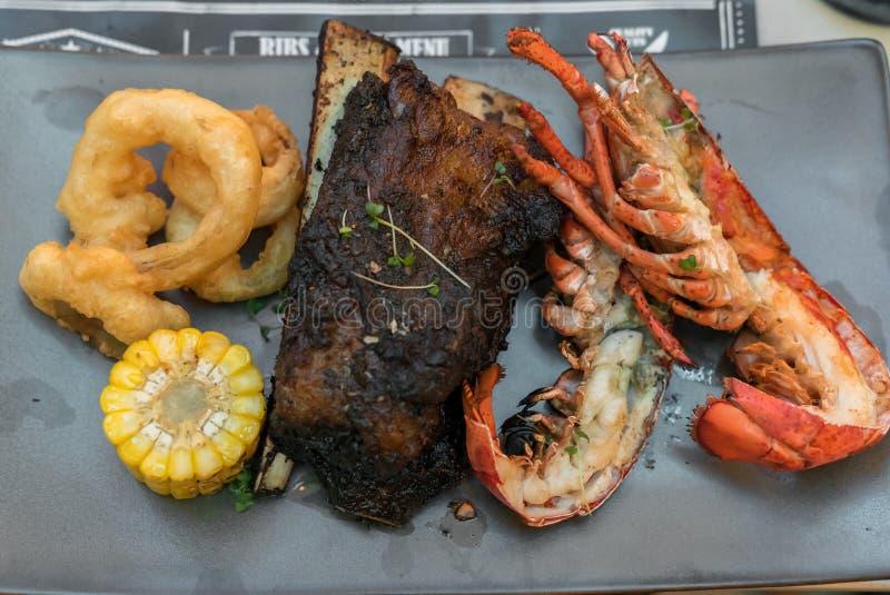 Kipiel, murawy wołowina i homar i fotografia stock