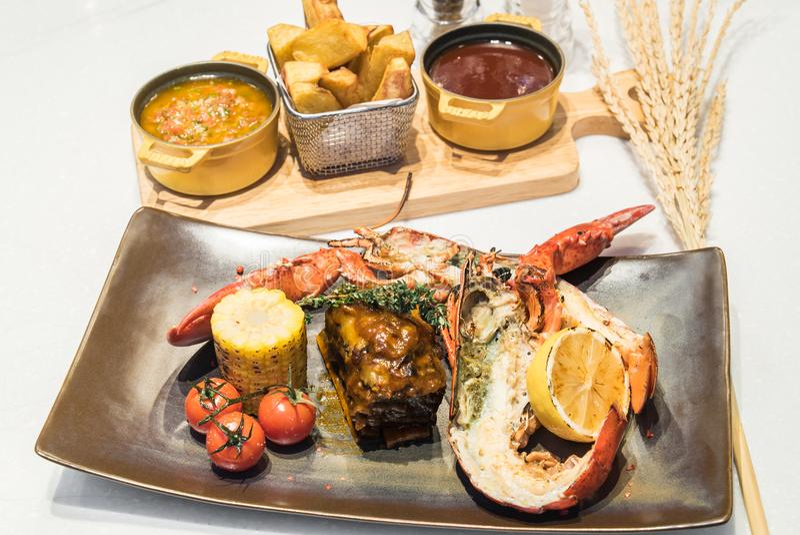 Kipiel, murawy wołowina i homar i zdjęcie stock