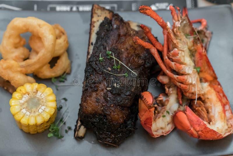 Kipiel, murawy wołowina i homar i zdjęcia stock