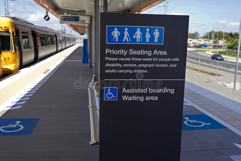 Kippa Ring Train Station. Priority Area sign within the boarding platform at the new Kippa Ring Railway Station on the Redcliffe Peninsula Line, Australia royalty free stock photos