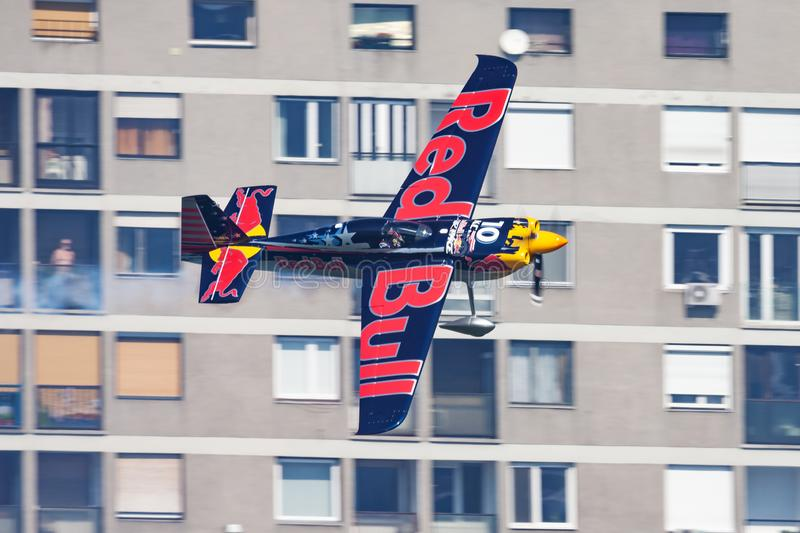 Kirby Chambliss with N14KN Zivko Edge 540 flying over Danube river in Budapest downtown at Red Bull Air Race 2015 royalty free stock images