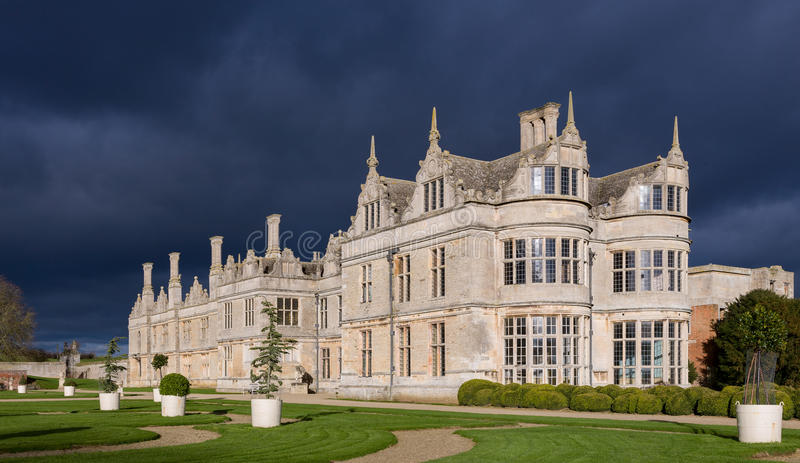 Kirby Hall and Approaching Storm. Kirby Hall in Northamptonshire just before a thunderstorm arrived, showing the very dramatic sky, dark grey clouds and formal stock images