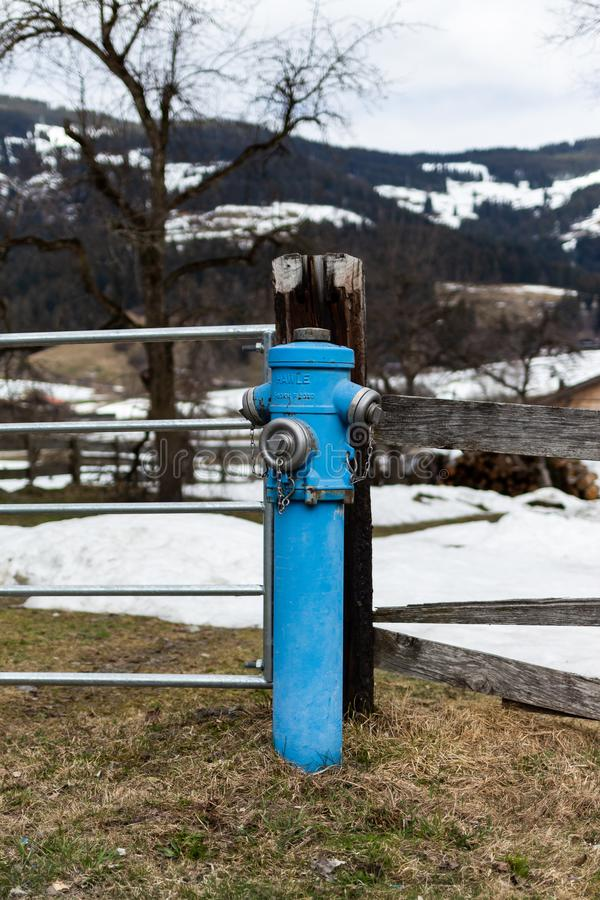 Kirchberg in Tirol, Tirol/Austria: March 28 2019: Blue fire hydrant royalty free stock photography