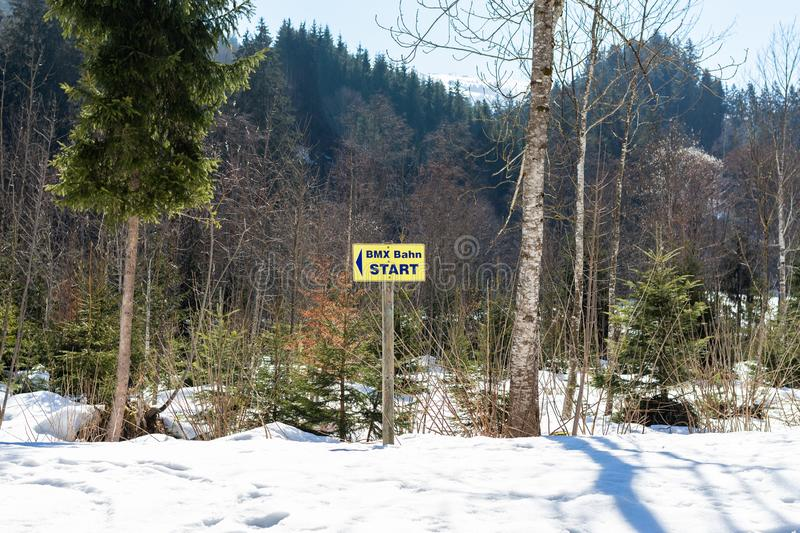 Kirchberg in Tirol, Tirol/Austria - March 24 2019: Sign post indicating the start of the BMX track on the mountain royalty free stock photo