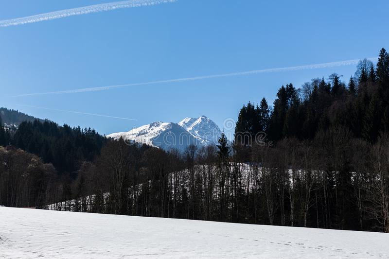Kirchberg in Tirol, Tirol/Austria - March 24 2019: View on a distant mountain top in the Austrian Alps royalty free stock photos