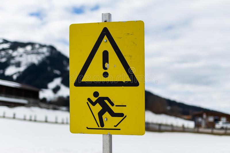 Kirchberg in Tirol, Tirol/Austria: March 28 2019: warning sign which warns for people on skies might cross the road here stock images