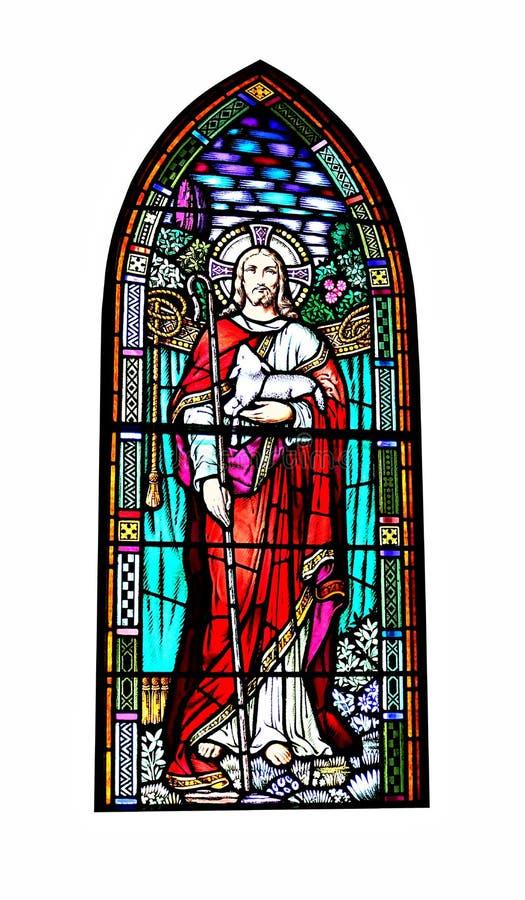 Kirchenbuntglasfenster von Jesus Christ ein Lamm halten stockbild