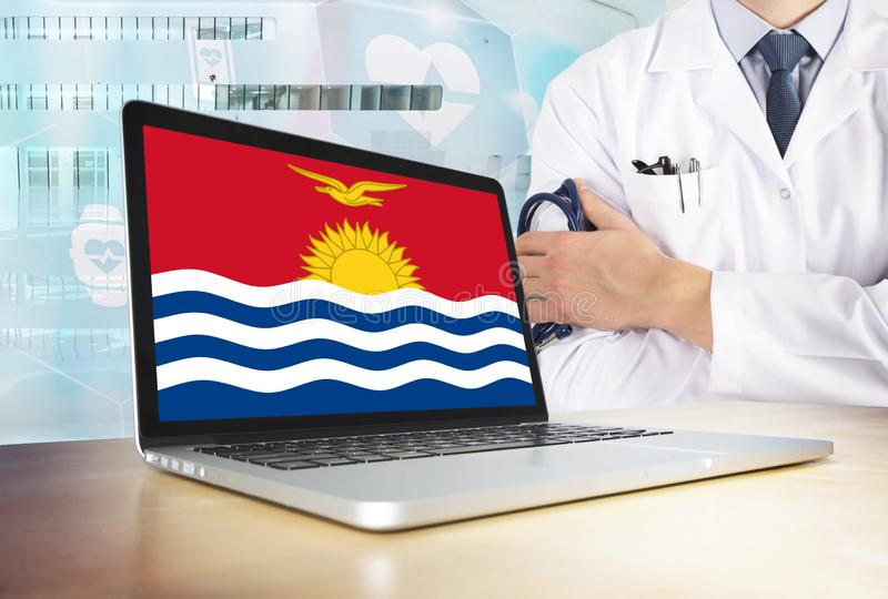 Kiribati healthcare system in tech theme. Flag on computer screen. Doctor standing with stethoscope in hospital. Cryptocurrency. And Blockchain concept royalty free stock photos