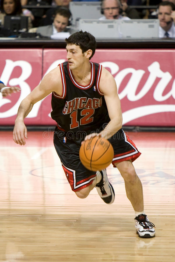 Kirk Hinrich. Has the ball during a game between the Detroit Pistons and the Chicago Bulls at the The Palace Of Auburn hills during the 2006-2007 season stock image