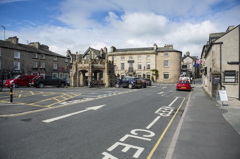 Kirkby Lonsdale, Cumbria. The old market square and market cross in Kirkby Lonsdale, Cumbria, England. The town was granted a charter to hold markets in the 13th royalty free stock photo