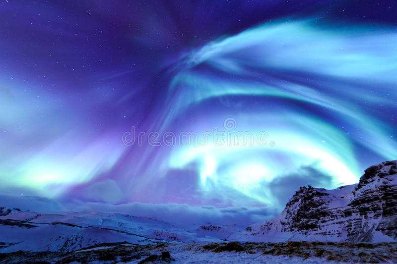 Kirkjufell and Aurora in Iceland. Mountain Kirkjufell and Aurora in Iceland royalty free stock photography