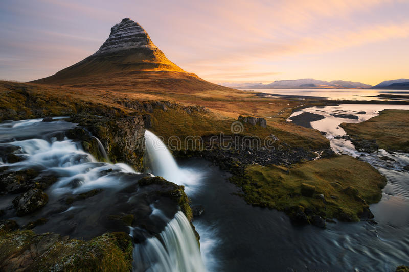 Kirkjufell in Iceland. Kirkjufell mountain in Iceland during sunrise royalty free stock photography