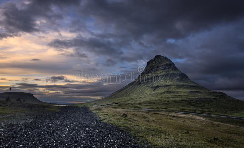 Kirkjufell mountain at Dusk. With a rock pathway on the left royalty free stock photo