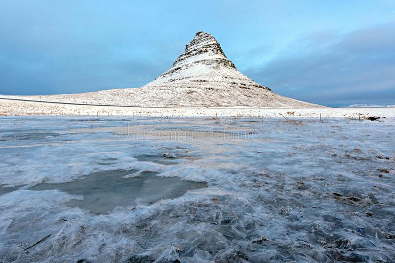 Kirkjufell Mountain with frozen water falls in winter, Iceland royalty free stock photos