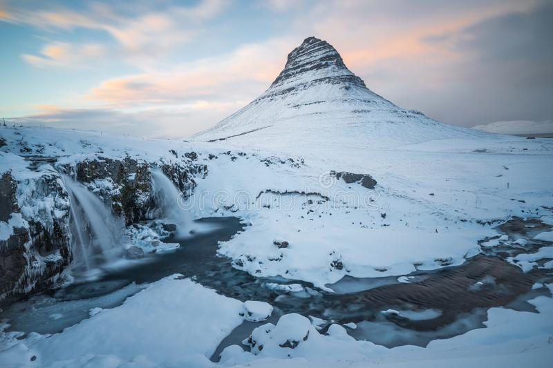 Kirkjufell mountain with waterfalls in Iceland. During sunset stock photos
