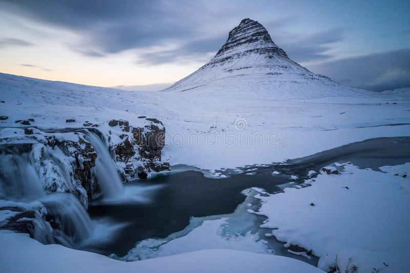 Kirkjufell mountain with waterfalls in Iceland. During sunset stock images