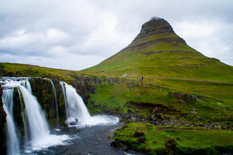 Kirkjufell volcano mountain, long exposure waterfall,  Iceland. Scenic panorama view of long exposure falling water in front of Kirkjufell volcano mountain, the royalty free stock photography
